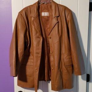 Tan leather jacket.